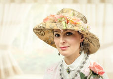 Adult woman with tapestry hat Royalty Free Stock Images