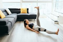Adult Woman Training ABS Abdominals Doing Scissors With Legs stock image