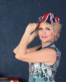 Adult woman in union jack cap Royalty Free Stock Photos