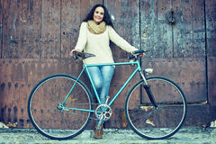 Adult woman with vintage bike Royalty Free Stock Photography