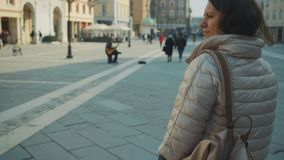 Woman is walking on Cavour square in Rimini. Adult woman is walking on Cavour square in Rimini in spring day stock video