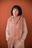Adult woman wearing crocheted shawl Stock Image