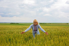 Adult woman in wheat field Royalty Free Stock Image