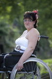 Adult woman in wheelchair outdoors Royalty Free Stock Photo