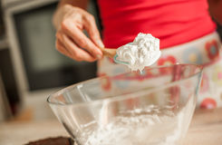 Adult woman whipping cream with whisk in glass bowl Royalty Free Stock Photos