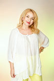 Adult woman in a white blouse with cute smiles. Stock Photo