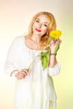 Adult woman in a white blouse with cute smiles and holding a yellow sunflower. Royalty Free Stock Photos