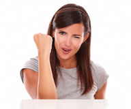 Adult woman with winking eye and winning gesture Royalty Free Stock Photos