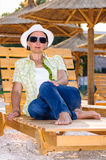 Adult woman on wooden lounge chair Stock Photos