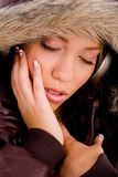 Adult woman with woolen coat enjoying music Stock Photo