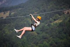 Adult woman on zip line. Adult woman on the zip line stock photography