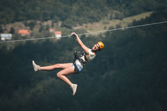 Adult woman on zip line. Adult beautiful woman on zip line stock photo