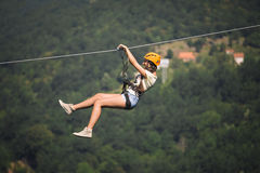 Adult woman on zip line. Adult beautiful woman on zip line royalty free stock images