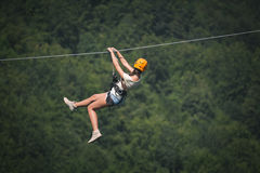 Adult woman on zip line. Adult beautiful woman on zip line stock images
