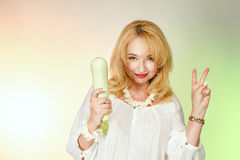Adult woman with zucchini. Royalty Free Stock Images