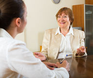 Adult women talking at the table Royalty Free Stock Photos