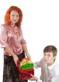 Adult women and teen boy giving gifts Stock Photos