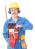 Adult worker in a uniform. Worker in a uniform with a chainsaw on white background Stock Images