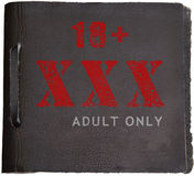 Adult only. XXX (adult only) on leather Stock Images