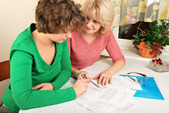 Adult and young women with documents Royalty Free Stock Photography