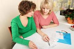 Adult and young women with documents Stock Image