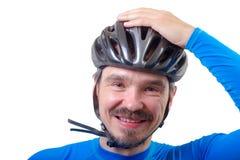 Adulto en casco de la bicicleta Imagenes de archivo