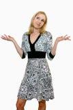 Adulto femenino que encoge sus hombros y que mira para arriba Fotos de archivo