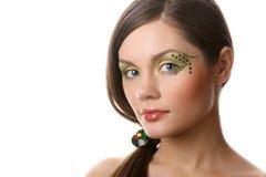 Adulto joven atractivo con maquillaje en blanco Imagen de archivo libre de regalías