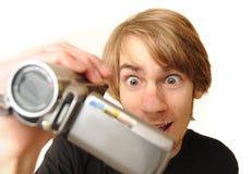 Adulto joven con la videocámara Foto de archivo libre de regalías