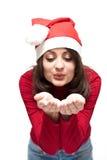Adulto joven de la Navidad en el sombrero rojo de santa Fotografía de archivo