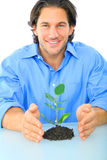Adulto joven que protege vida verde Imágenes de archivo libres de regalías