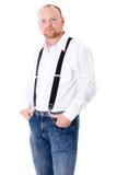 Adulto masculino en la camisa, las paréntesis y los pantalones vaqueros blancos Imagen de archivo