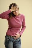 Adulto que tiene dolor de la menstruación Imágenes de archivo libres de regalías
