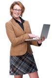 Adulto y computadora portátil de trabajo Fotografía de archivo libre de regalías
