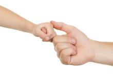 Adulto y niño de la mano Imagen de archivo