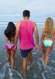 Adultos jovenes en la playa Foto de archivo libre de regalías