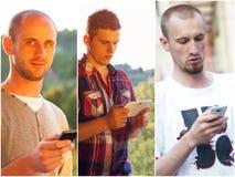 Adultos jovenes usando smarphones Foto de archivo libre de regalías