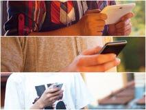 Adultos jovenes usando smarphones Imágenes de archivo libres de regalías