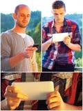 Adultos jovenes usando smarphones Imagen de archivo libre de regalías