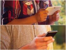 Adultos jovenes usando smarphones Fotografía de archivo