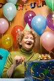 Adultos mayores en un partido Fotos de archivo libres de regalías