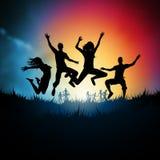 Adultos novos de salto Imagem de Stock Royalty Free