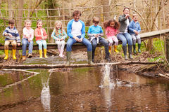Adults With Children On Bridge At Outdoor Activity Centre Royalty Free Stock Photography