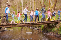Adults With Children On Bridge At Outdoor Activity Centre stock images