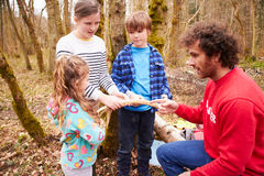 Adults And Children Examining Animal Horn At Activity Centre Stock Photos