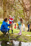 Adults And Children Exploring Pond At Activity Centre Royalty Free Stock Photography