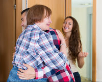 Adults children greeting mother Stock Photo