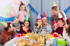 Adults with children are having good time Royalty Free Stock Image