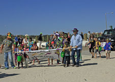 Adults and Children Lead the Barefoot Mardi Gras Parade. Local adults and children carry the banner to open the Barefoot Mardi Gras Parade on February 25, 2017 Stock Photos