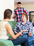 Adults children quarrel  with mother Stock Image